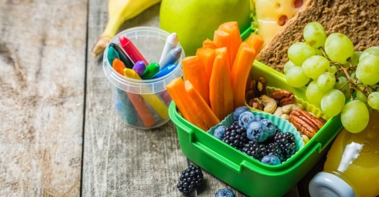 kids lunch box with carrot sticks, grapes and blueberries.